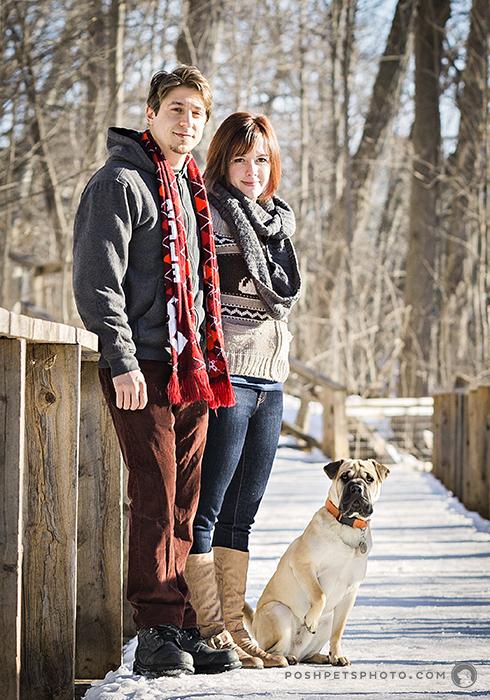 young couple with dog on bridge