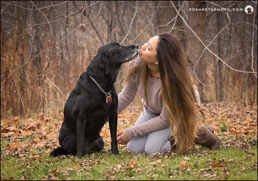 black labrador giving a girl a kiss