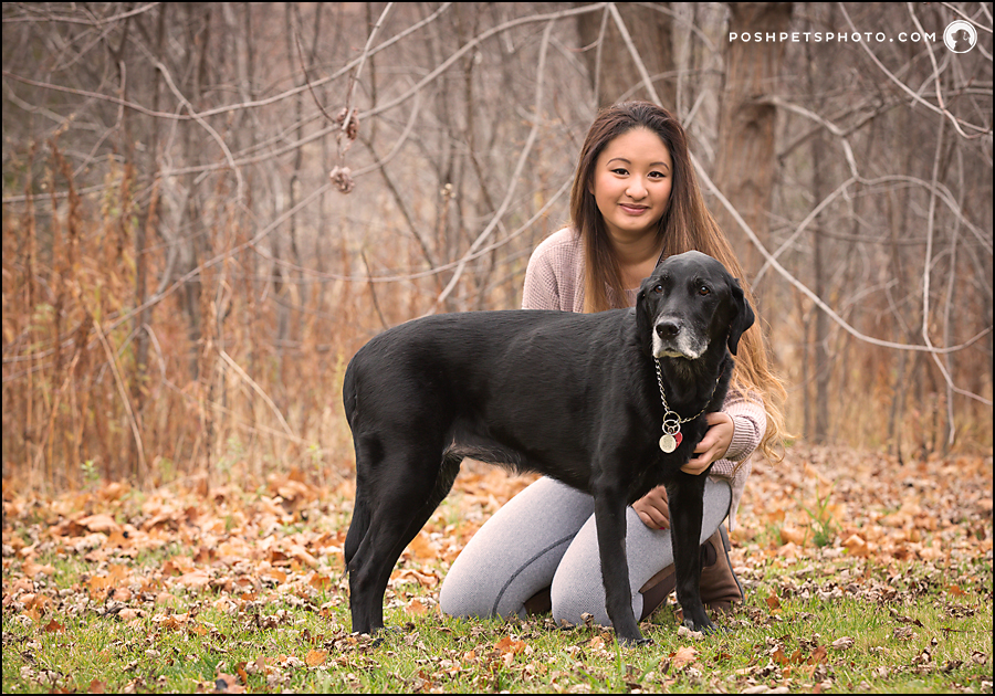 portrait of a chinese girl and black labrador