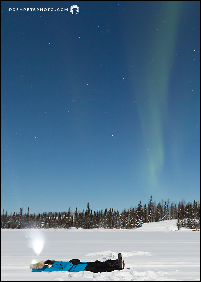 breath in cold air under aurora